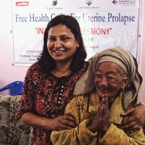 Founder of CWN, Indira Thapa and a woman at a CWN health camp who is showing immense gratitude for the reproductive health services that she has just been provided